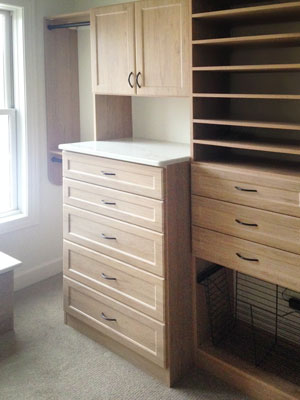 Closet hutch in ginger root thermally fused laminate with pull-out hamper