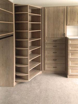Walk-in closet in ginger root thermally fused laminate with the shoe spinner 360 Organizer by Lazy Lee