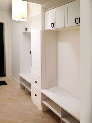 custom white laminate mud room with bead board backing
