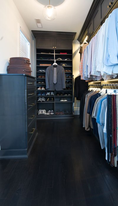 custom walk in closet for him with custom lighting