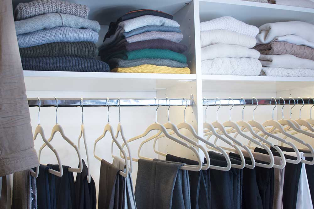 Closet size standards for stacks of folded clothing and hanging rod