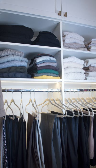 custom walk in closet designs with hanging space, shelves and custom closet lighting