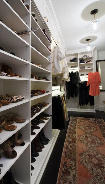 long view of luxury walk in closet designs with close up of shoe shelves