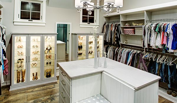 Walk-in closet designs include island with drawers and built-in seating