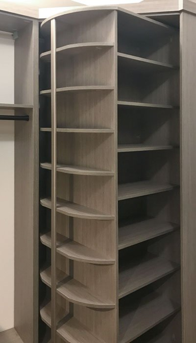 walk in closet with 360 shoe organizer