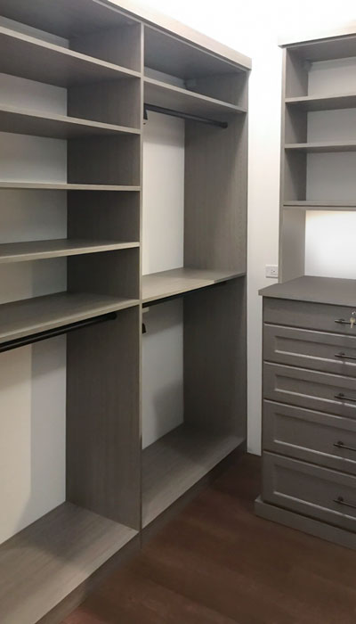 custom walk in closet in haze laminate with oil rubbed bronze rods