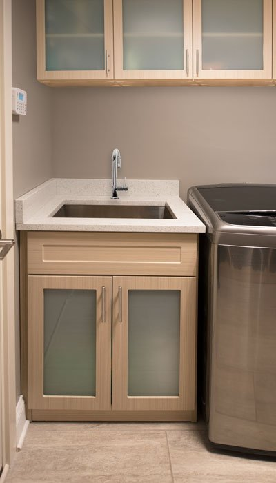 modern laundry room cabinetry design
