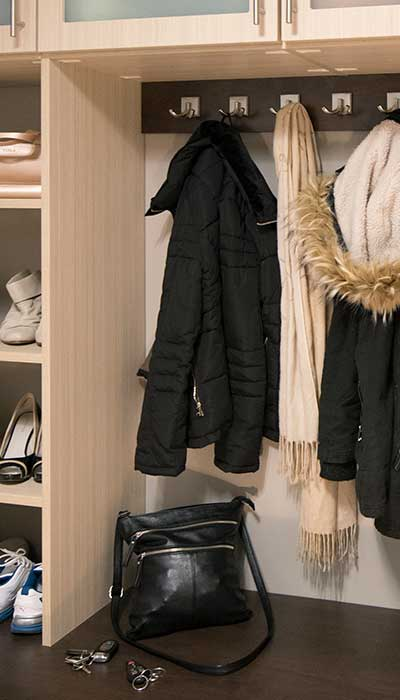 Mud room lockers with scarf and jacket on a hook