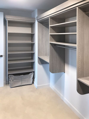 custom walk in closet with built in laundry hamper