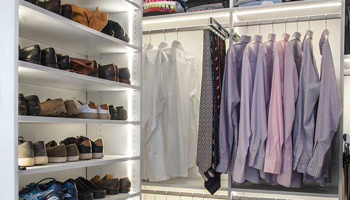 shoe tower in closet with vertical lighting system