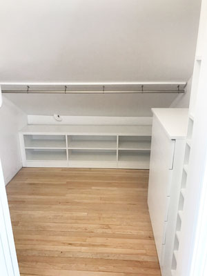 Sloped Ceiling Closet with Sloped Hanging
