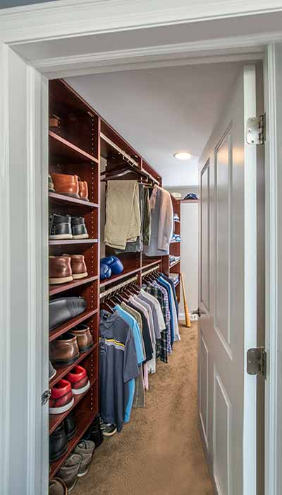 Long, narow closet with swing-in door