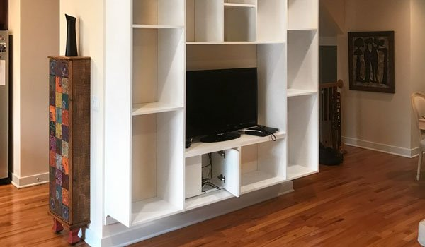 contemporary media center with wire management doors