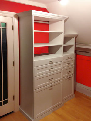 custom white laminate walk-in closet unit for sloped ceiling