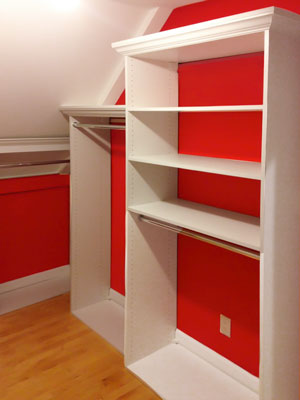 custom white laminate walk-in closet for sloped ceiling