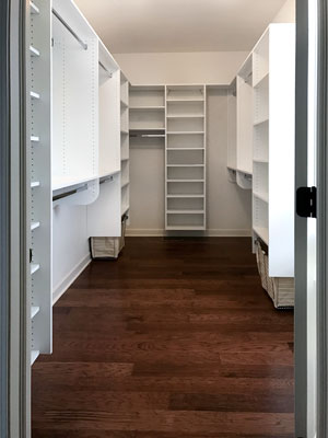 custom white laminate closet with baskets