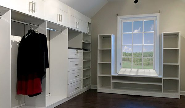 Attic closet with sloped ceiling and slanted walls