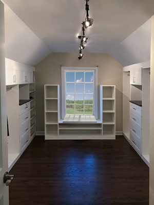 custom white laminate closet for sloped ceiling room