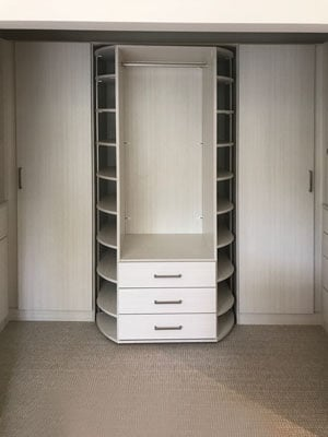 360 organizer Valet in center of closet cabinetry