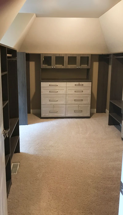 walk in closet system for slanted ceiling room in blackwood