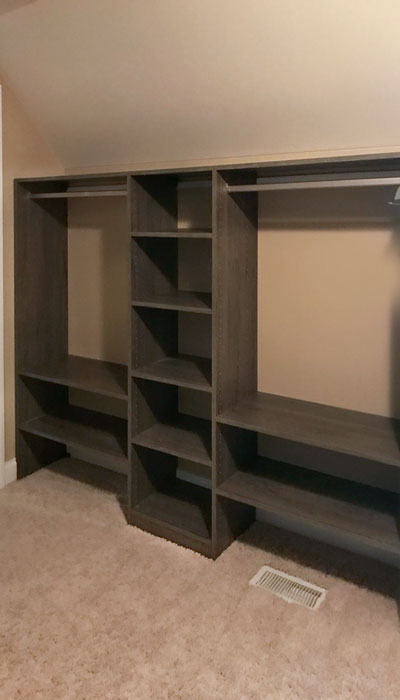 walk in closet organization system for sloped ceiling room in blackwood