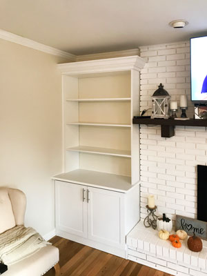 white fireplace surround with bar handles