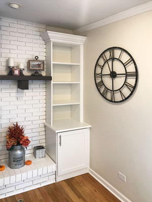 white fireplace surround wall unit with bar handles