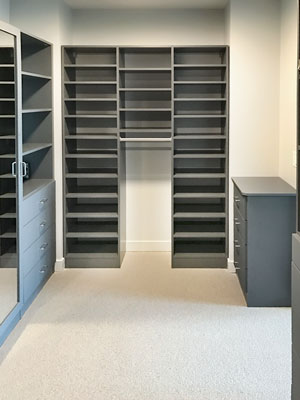 custom walk in closet with shoe shelves