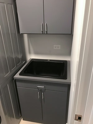 laundry room cabinets and sink cut out