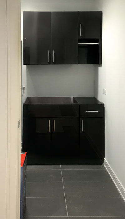 laundry room cabinets in black high gloss laminate