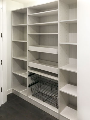 white chocolate pantry with wire baskets and pull-out shelves