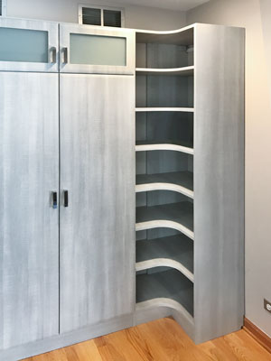 entryway storage with curved shelves and glass inserts