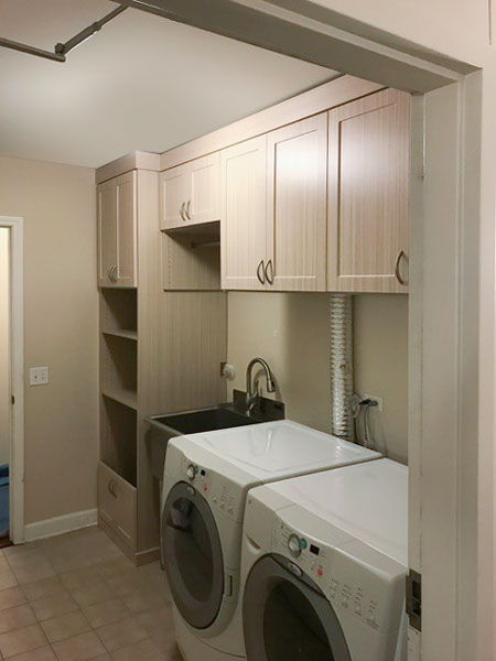 laundry room design with crescent hardware