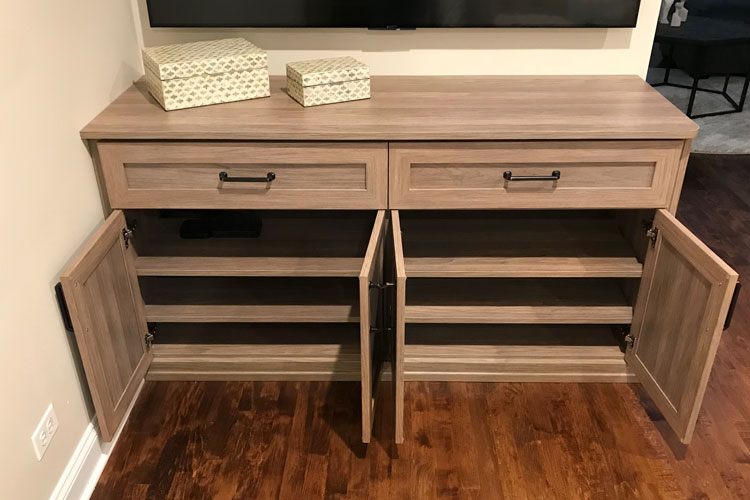 entertainment center offers cabinets with shelves for media storage