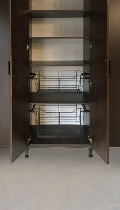 Custom garage cabinetry with shelving and pull-out baskets