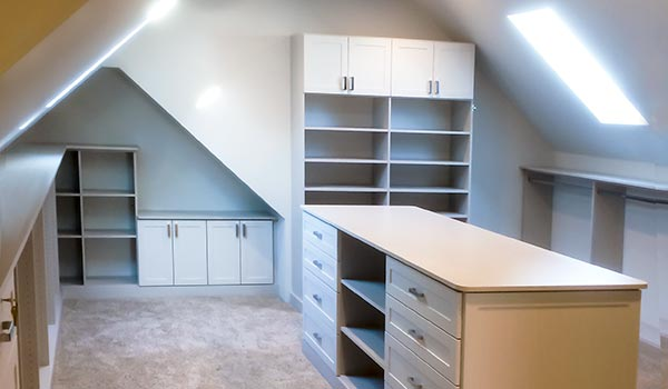 Custom Walk-in closet with a slanted wall shelf and ceilings