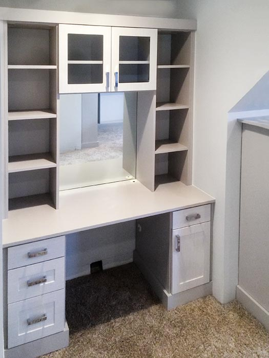 custom vanity with makeup area designed for closet with angled, sloped ceilings