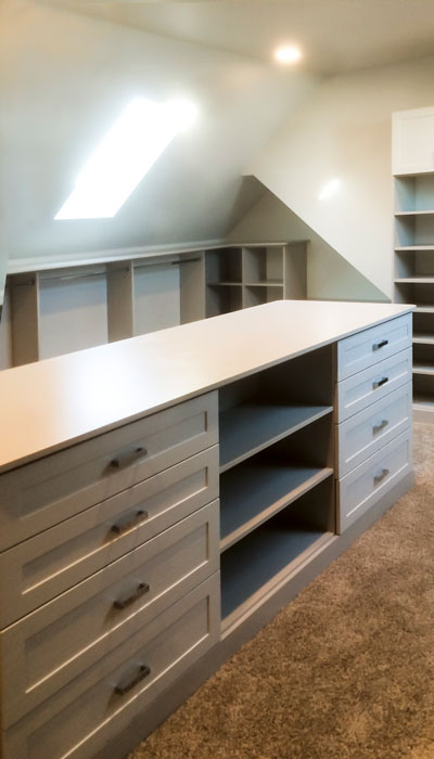 walk in closet island with shaker mission drawers