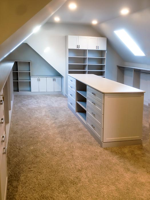 custom closet organization system for bonus room with angled, sloped ceilings