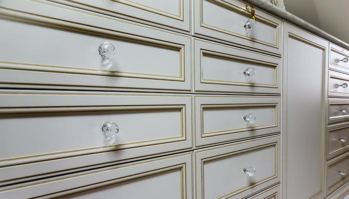 Portabella cabinet door with crystal Swarovski knobs on closet island
