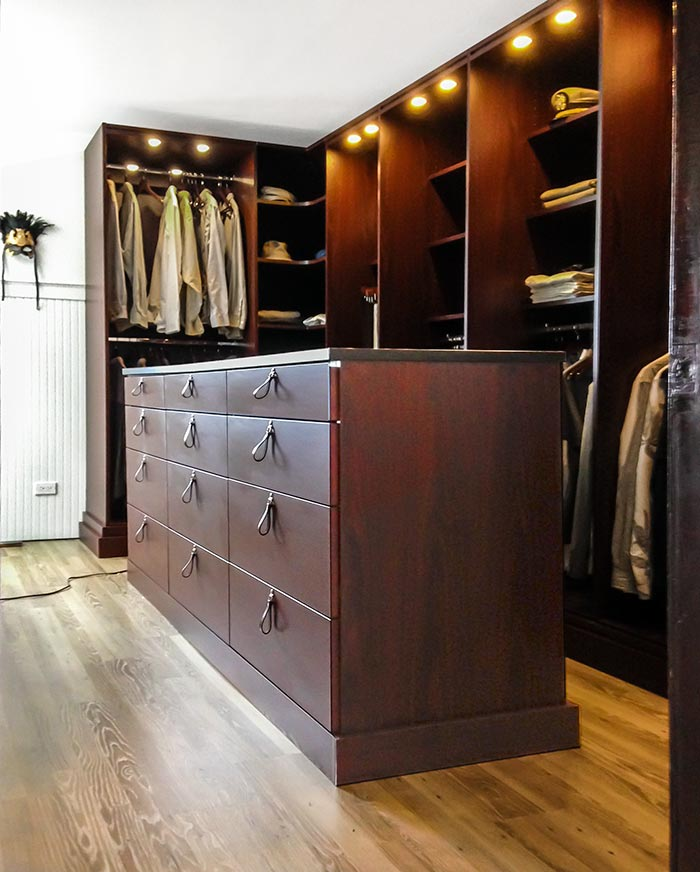 Custom Closet System And Center Island Adds Extra Storage