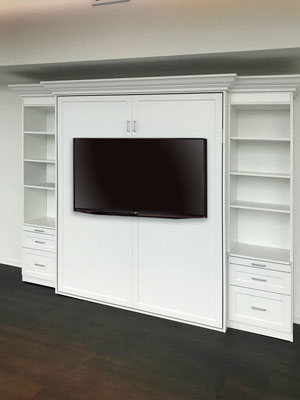 wall bed transforms guest room into media center