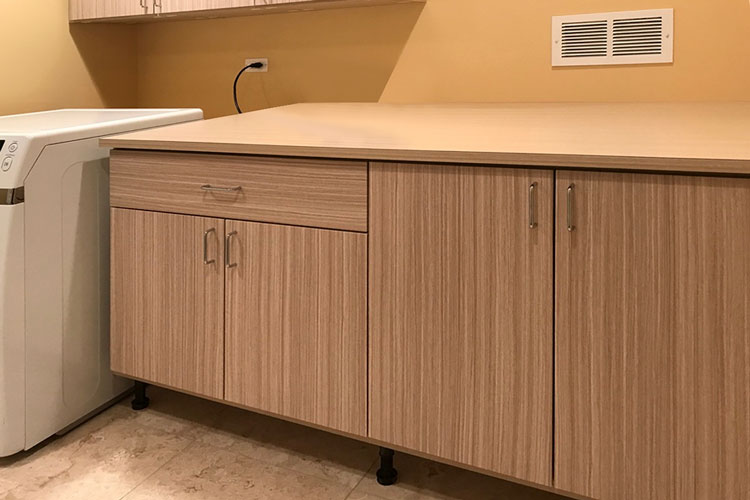 expansive laundry room countertop for folding clothing