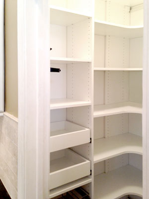 white laminate pantry with vertical tray dividers