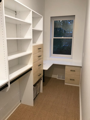 walk in closet with built in desk