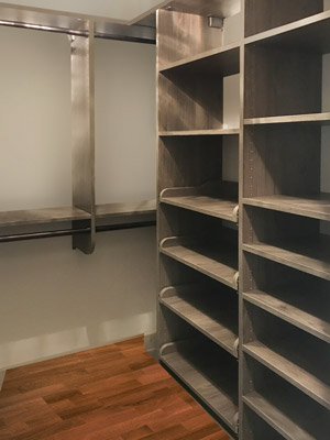 walk in closet with pull out shelves and double hang