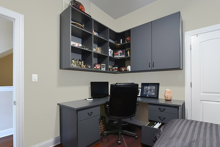 Home Office With Corner Desk System And Overhead Display