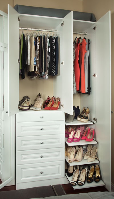 Side of bedroom wardrobe closets featuring storage potential and slide-out shoe shelves