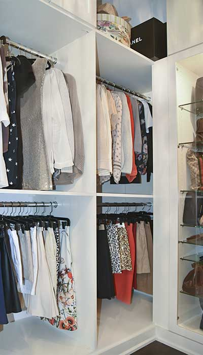 custom walk in closet bedroom to closet conversion with double hang clothing rods
