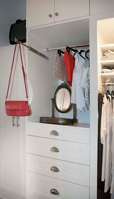 closet drawers with scalloped hardware
